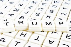 Trump title text word crossword. Alphabet letter blocks game texture background. White alphabetical letters on black royalty free stock photos