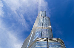 Trump Tower in Chicago. Chicago, USA - May 24, 2014: The Trump Tower with blue sky seen from Chicago River Stock Images