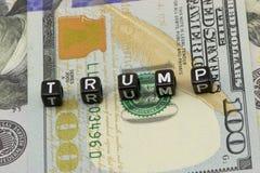 Trump word on dollars Stock Photos