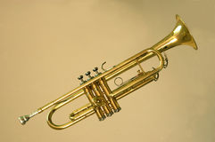 Trumpet. A trumpet in same tone background Stock Image