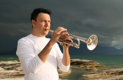 Trumpet. A man playing trumpet outdoor Royalty Free Stock Photography