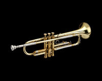 Trumpet. Wind instrument. On a black background stock photos
