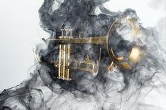 Trumpet Abstract Jazz Smoke. Abstract smoke billows around jazz brass trumpet Royalty Free Stock Images