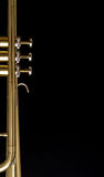 Trumpet background. With valves on black background Stock Photo