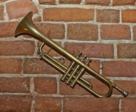 Trumpet on brick wall background Stock Photo