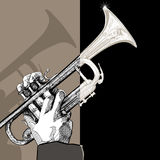 Trumpet on brown background Royalty Free Stock Images