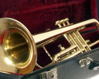 Trumpet In Case. Trumpet sitting in a lined case; narrow depth of field on bell stock photography
