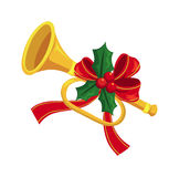 Trumpet. Decorated with holly and ribbon Royalty Free Stock Photography
