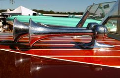 Trumpet Horns With Refletion on Wooden Speed Boat Detail Royalty Free Stock Photography