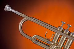 Trumpet Isolated on Gold Spotlight Stock Photography