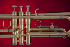 Trumpet Isolated On Red Background. A professional trumpet isolated against a spotlight red background Royalty Free Stock Images