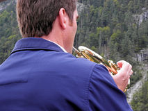Trumpet man at the lake Koenigsee,Germany Royalty Free Stock Photography
