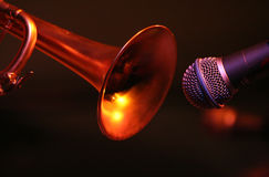 A trumpet and a microphone in closeup position Stock Image