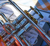 Trumpet on musical score, wind instrument Stock Images