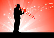 Trumpet Musician on Red Background with Notes Stock Photo