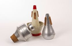 Trumpet Mutes. Three different mutes used to change the sound made by the trumpet (Harmon Mute, cup mute, straight mute Stock Images