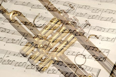 Trumpet and notes. Book on each other Stock Images