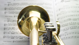 Trumpet at notes. Trumpet in front of notes stock photo