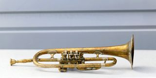 Trumpet. Old battered and bended trumpet in bad condition Stock Photography