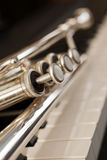 Trumpet on piano keys Royalty Free Stock Photos