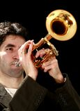 Trumpet player. On a black background and his golden trumpet Royalty Free Stock Images
