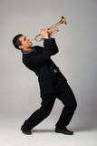 Trumpet Player. Portrait of a young man playing his Trumpet Stock Photos