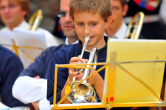 Trumpet player. EVOLENE, SWITZERLAND - AUGUST 15: young trumpet player at the International Festival of Folklore and Dance from the mountains (CIME) : August 15 Stock Image