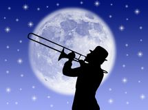 Trumpet player. A trumpet player in the night against the moon stock photo