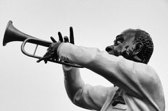The Trumpet Player. Is he, or isnt he a real trumpet player?  Part of a jazz parade float Royalty Free Stock Images