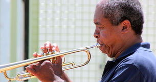 Trumpet player. African american male trumpet player performing on stage outdoors Royalty Free Stock Photography
