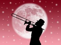 Trumpet player. A trumpet player in the night against the moon Stock Images