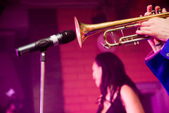 Trumpet player. Playing into microphone on a stage Stock Photos