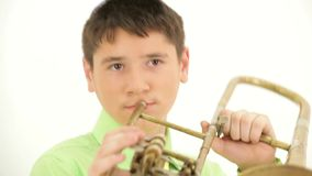 Trumpet Player. Boy playing the trombone. On the child's head pile, he was a Jew stock video footage