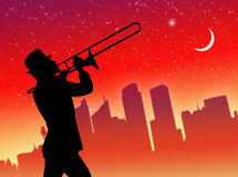 Trumpet player in the city Stock Photography