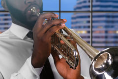 Trumpet player on city background. Stock Photos