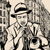 Trumpet player on a cityscape background Royalty Free Stock Image