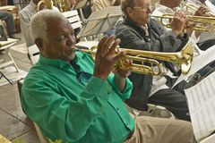Trumpet player with large big band in streets of Old Havana, Cuba Stock Images