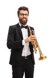 Trumpet player looking at the camera and smiling. Isolated on white background Stock Images