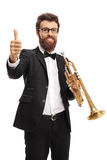 Trumpet player making a thumb up gesture. Isolated on white background Royalty Free Stock Photos