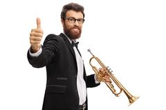 Trumpet player making a thumb up gesture. Isolated on white background Stock Photos