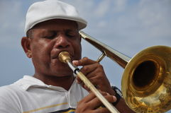 Trumpet player on malecon havana cuba. Musician reflection of old buildings Royalty Free Stock Photos
