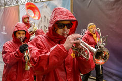 Trumpet player marching  under rain at Carnival parade, Stuttgart Stock Photography
