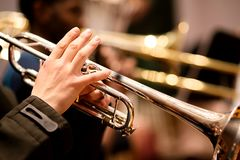 Trumpet player performing in an orchestra. Trumpet player performing in a symphony orchestra Royalty Free Stock Image