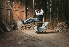 Trumpet Player. Is Playing and Levitating in Wooden Shed Interior Royalty Free Stock Photography