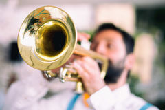 Trumpet player. A retro style trumpet player with braces Royalty Free Stock Photo