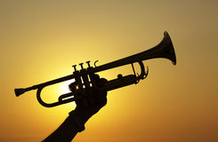 Trumpet Player. Silhouettes of trumpet player at sunset Stock Image