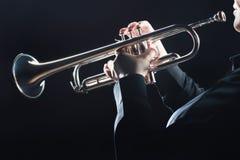 Trumpet player hands. Trumpet player. Trumpeter hands playing wind brass musical instrument closeup Stock Photography
