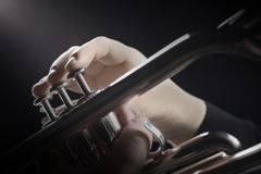 Trumpet hands. Trumpet player. Trumpeter hands playing wind musical instrument closeup Royalty Free Stock Image