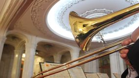 Trumpet playing. And beautiful big chandelier stock video footage