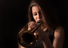 Trumpet playing women Stock Images